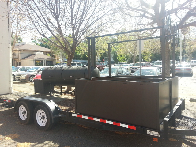 Our Mobile Smoker And BBQ Trailer, capable of cooking up to 600 Pounds of Meat!!!!